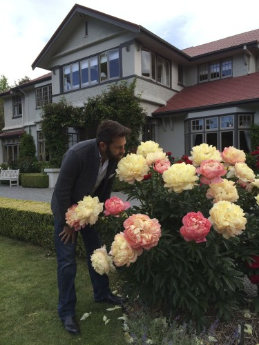 Me sniffing 'Coral Charm' peonies at the Saturday evening cocktail party at Timara Lodge