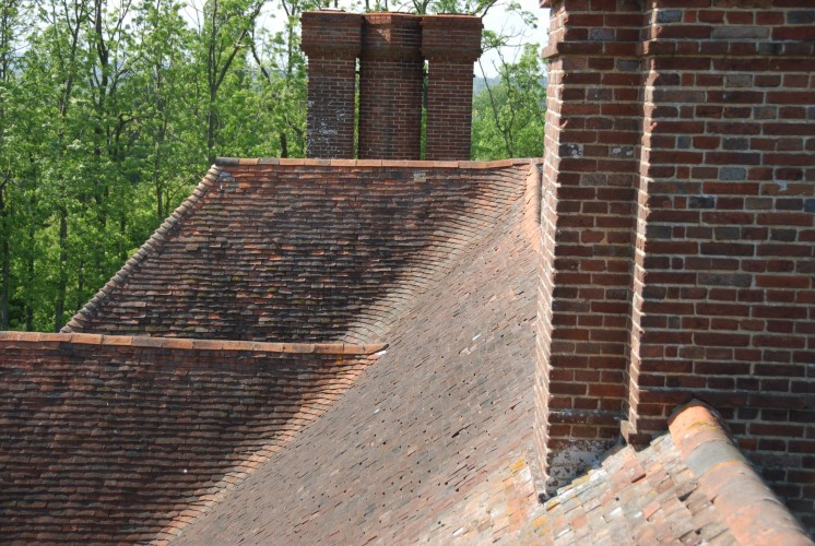 The roof - taken from the roof - showing those incredible swept valleys, in which the tiles are slid into a very lightweight mortar made from ash from steam-trains, in order to avoid valley guttering where the roof changes direction